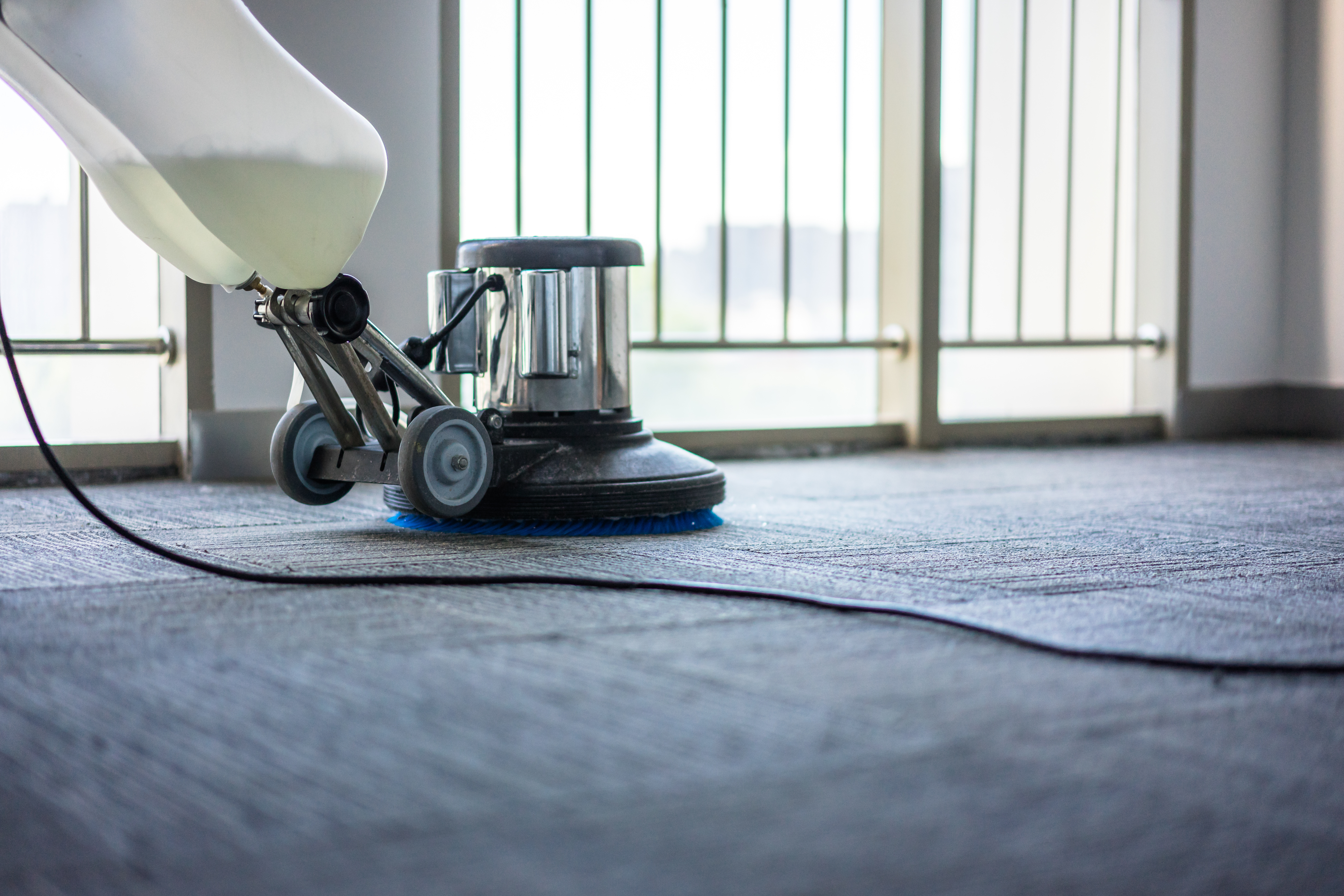 washing floor with machine